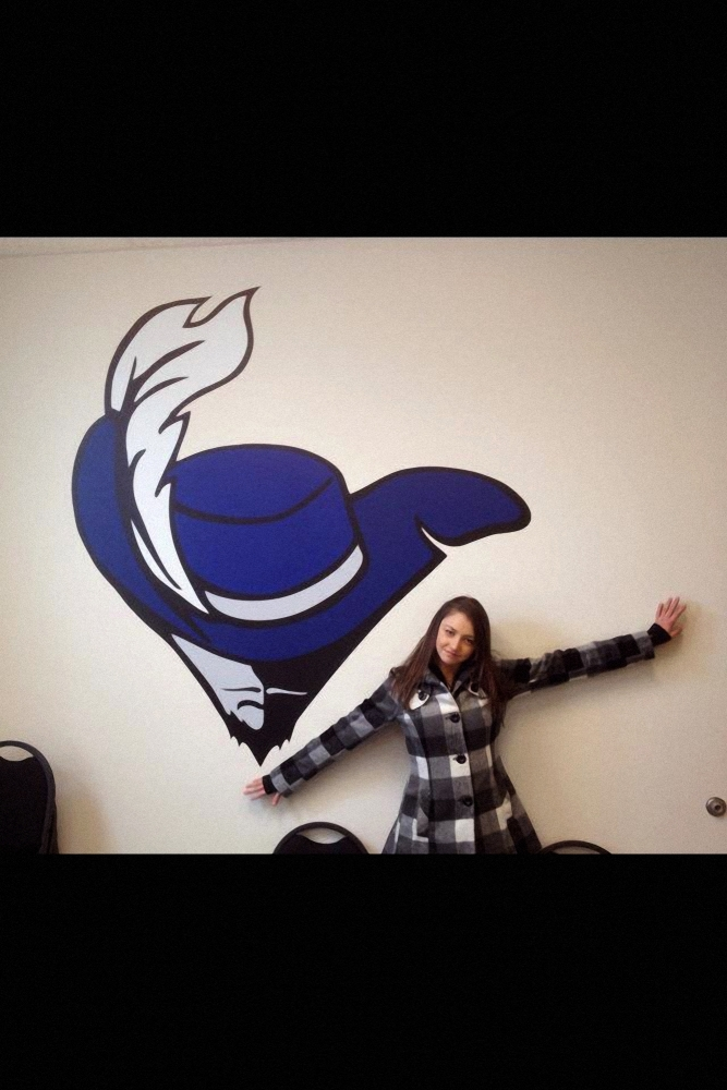 Wall graphic with feathered hat Sign Studios