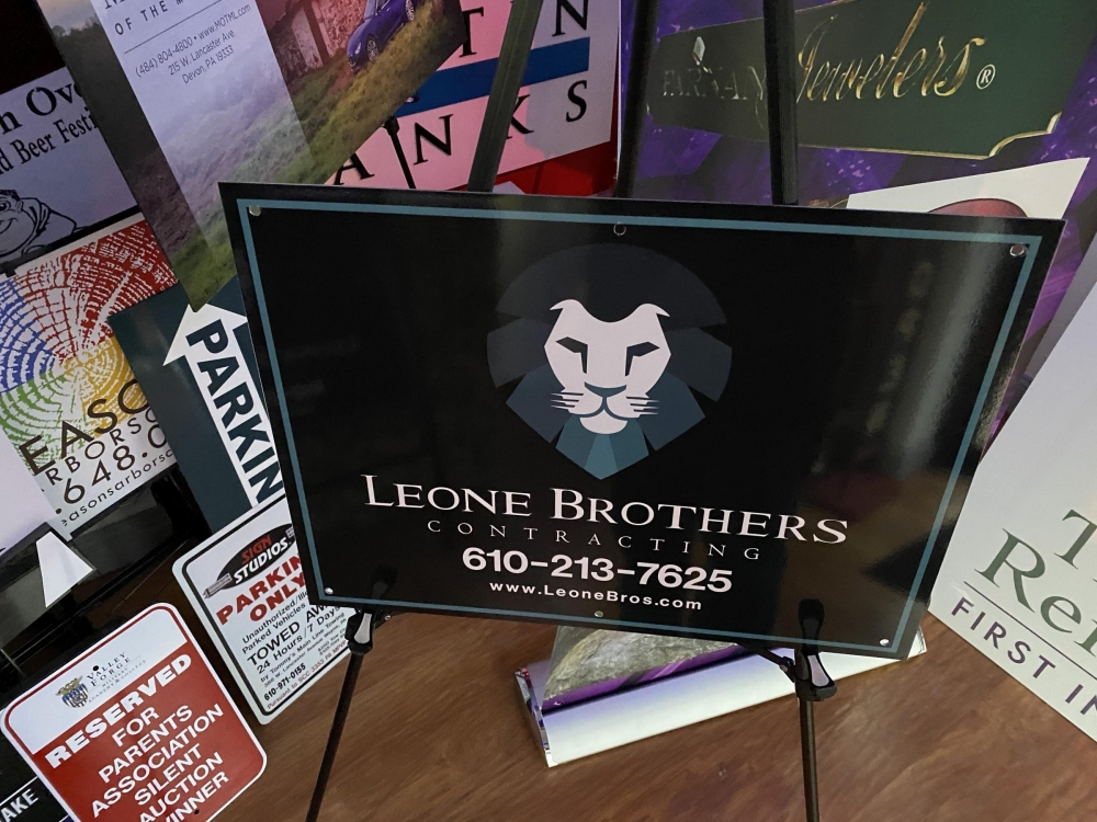Leone Brothers Sign on Stand