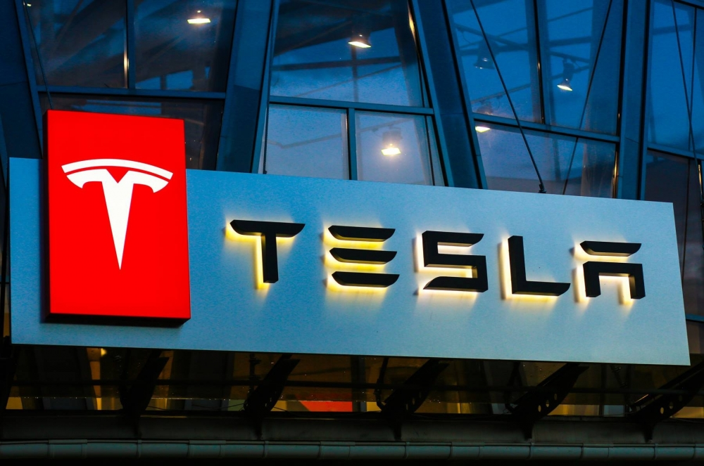 Tesla Channel Letters and Illuminated Cabinet