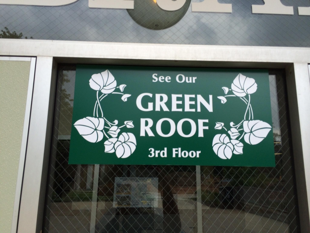 Green Roof Window Sign