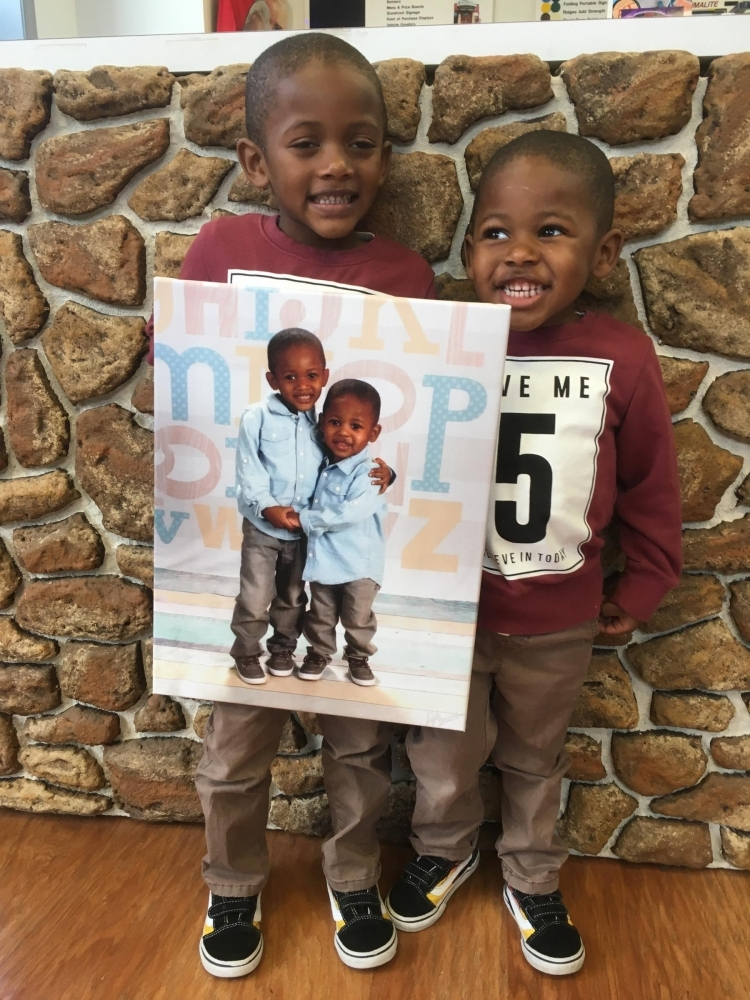 Brothers Holding Photo