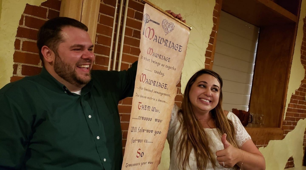 Mawriage Scroll held up by the Bride and Groom
