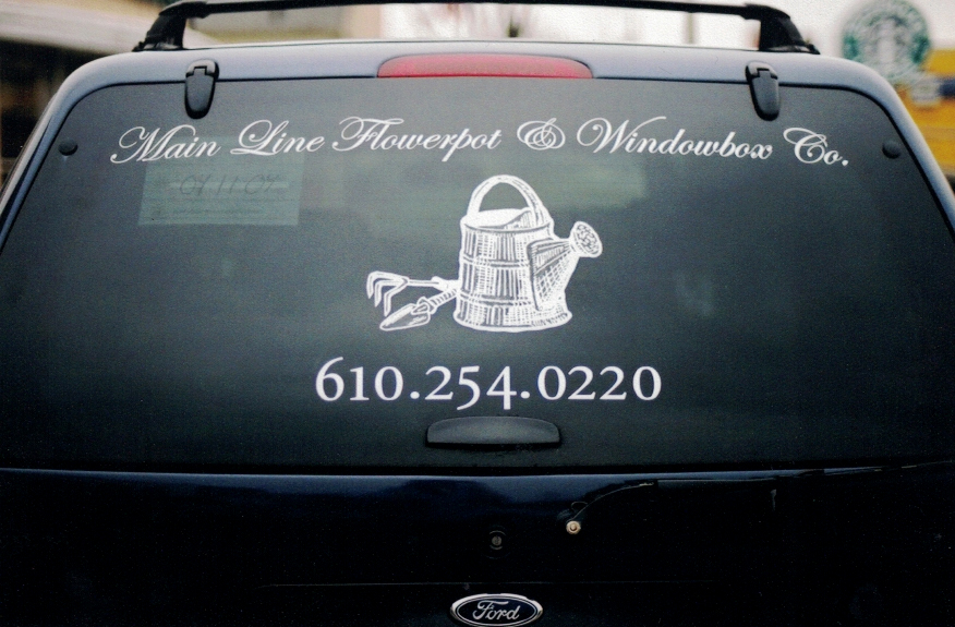 Main line flowerpot vehicle lettering Sign Studios