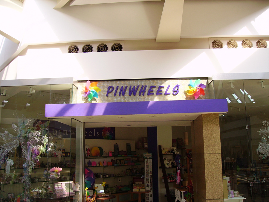 Pinwheels retail Sign Studios