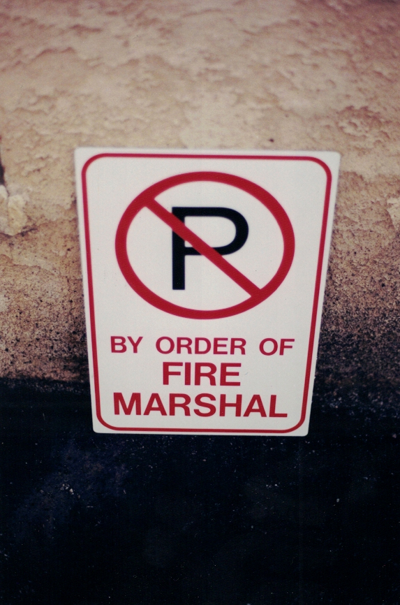 by order of Fire Marshal parking Sign Studios