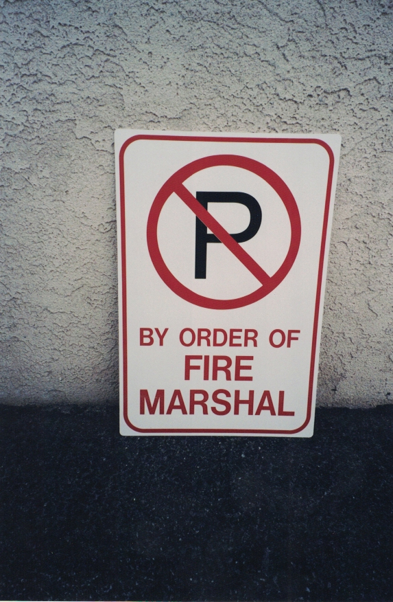 by order of Fire Marshal parking 2 Sign Studios