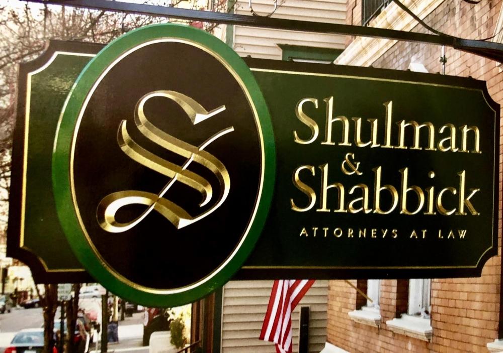 Shulman & Shabbick Hanging Sign